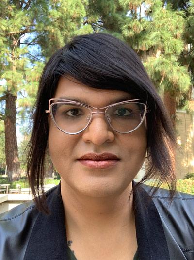 Photograph of Naomi Kanakia wearing pointed glasses.